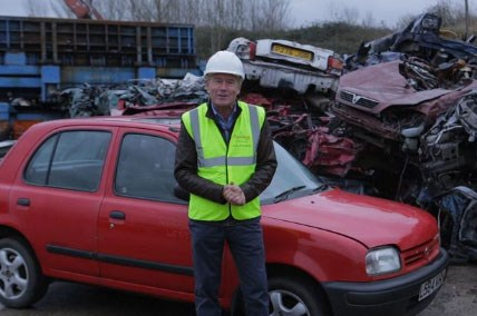 Tiff about to scrap a Nissan Micra at a scrapyard