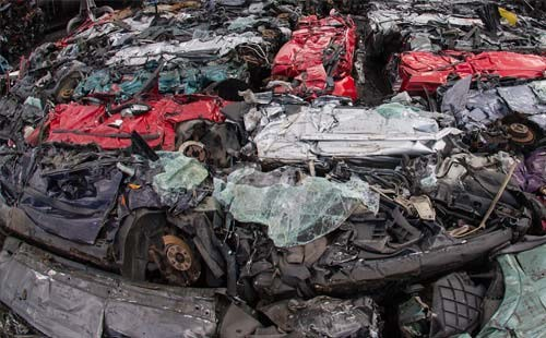 Mountain of scrap cars at recycling centre