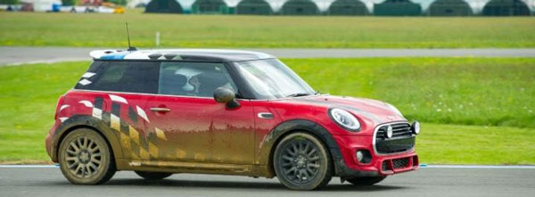 Star in a car takes a Mini Cooper out for a drive on the Top Gear race track