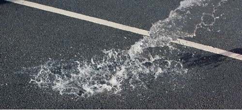 water draining through a road surface