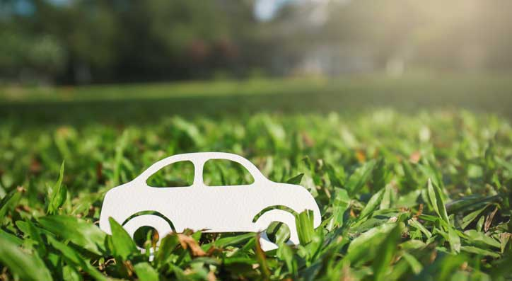 Paper car in Grass. Recycle your car this World Environment Day