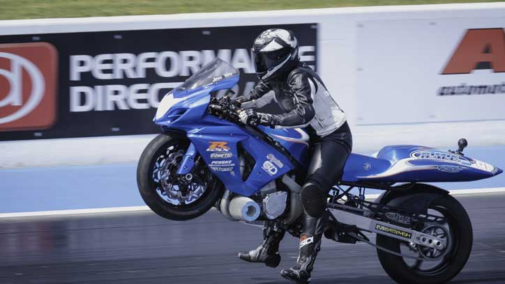Jem Venables, part of father daughter team Ven Racing, fighting to control her Super Street Bike