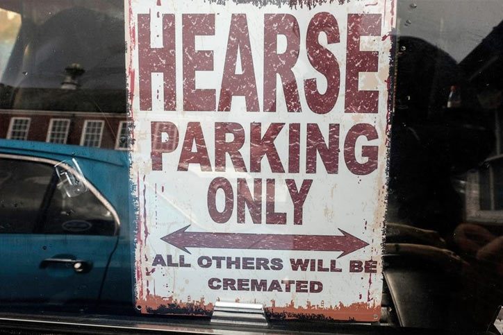 Hearse Parking Only sign in window
