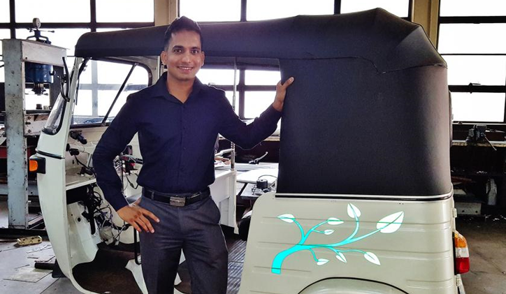 Photo courtesy of Sasiranga De Silva. De Silva with his invention. Electric Tuk-tuk