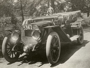Florence Lawrence behind the wheel of a Lozier Open TOuring car